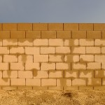 The absorbtion patterns of cinder-block walls.